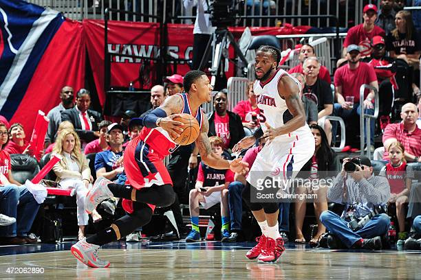 Bradley Beal of the Washington Wizards drives to the basket against DeMarre Carroll of the Atlanta Hawks during Game One of the Eastern Conference...