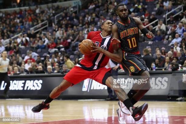 Bradley Beal of the Washington Wizards drives to the basket against Tim Hardaway Jr #10 of the Atlanta Hawks in the first half at Verizon Center on...