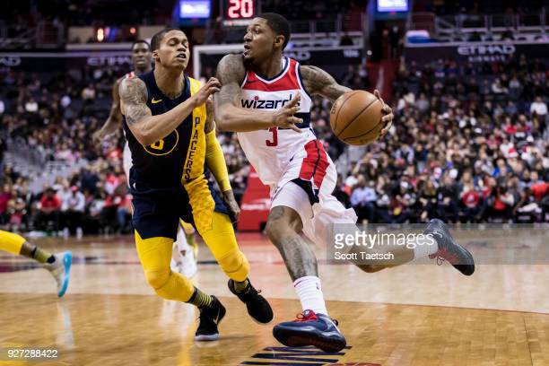 Bradley Beal of the Washington Wizards drives to the basket against Cory Joseph of the Indiana Pacers during the second half at Capital One Arena on...