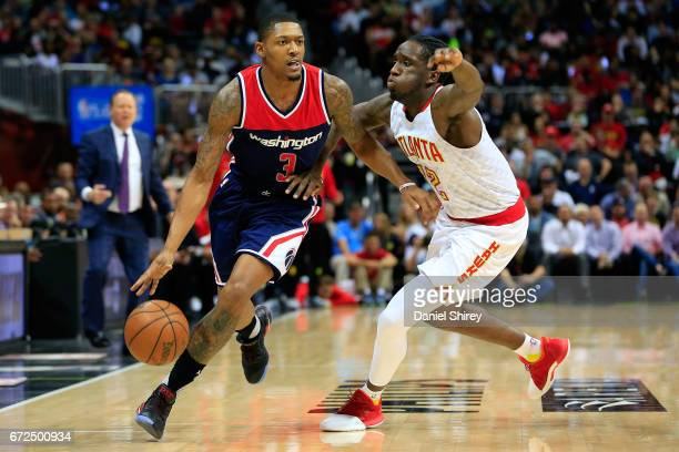 Bradley Beal of the Washington Wizards drives to the basket past Taurean Prince of the Atlanta Hawks during the first quarter in Game Four of the...