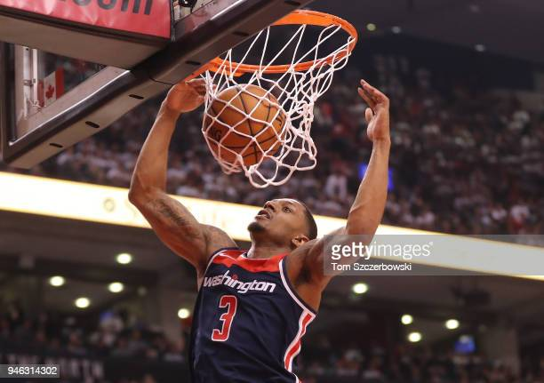 Bradley Beal of the Washington Wizards dunks against the Toronto Raptors in the first quarter during Game One of the first round of the 2018 NBA...