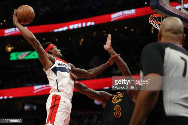 Bradley Beal of the Washington Wizards dunks on Andre Drummond of the Cleveland Cavaliers during the second half at Capital One Arena on February 21...