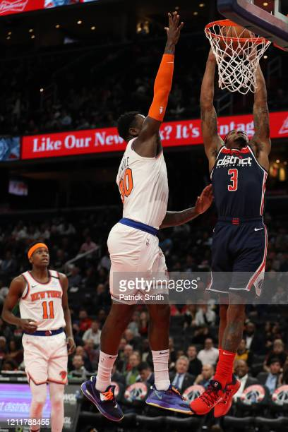 Bradley Beal of the Washington Wizards dunks on Julius Randle of the New York Knicks during the second half at Capital One Arena on March 10 2020 in...