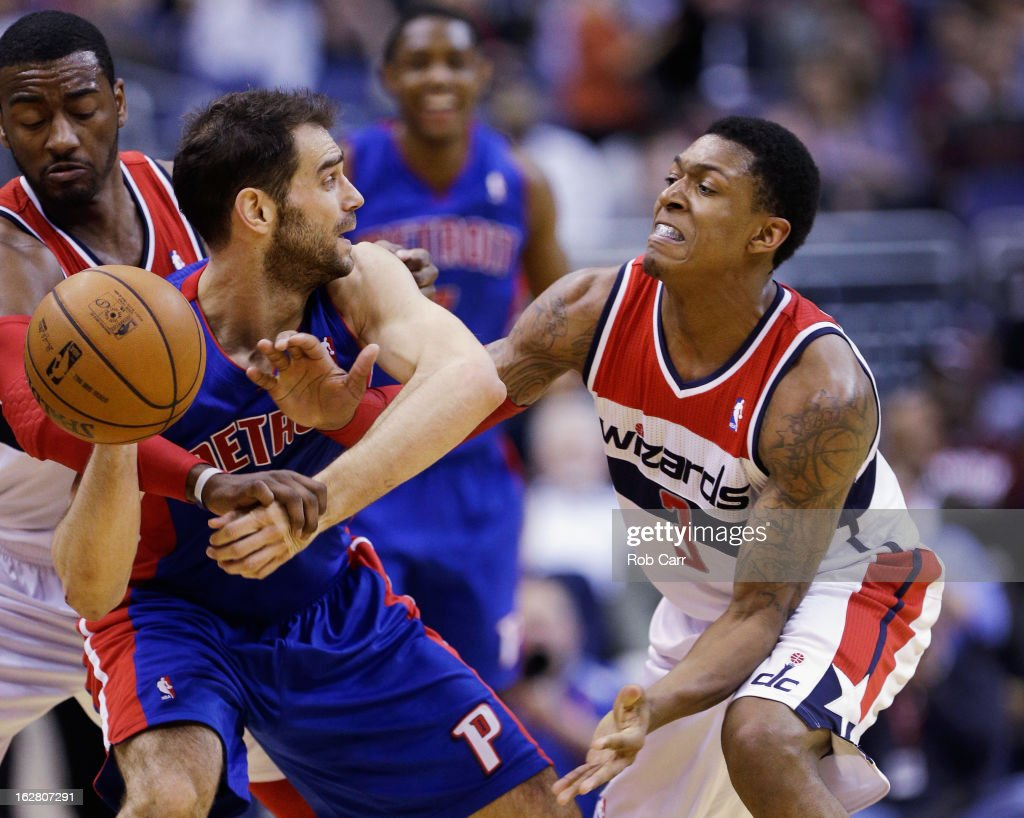 Bradley Beal #3 of the Washington Wizards fouls Jose Calderon #8 of the Detroit Pistons during the second half as John Wall #2 of the Washington Wizards looks on during the Pistons 96-95 win at Verizon Center on February 27, 2013 in Washington, DC.