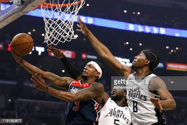 Bradley Beal of the Washington Wizards goes up for a shot as Montrezl Harrell and Maurice Harkless of the Los Angeles Clippers defend during the...