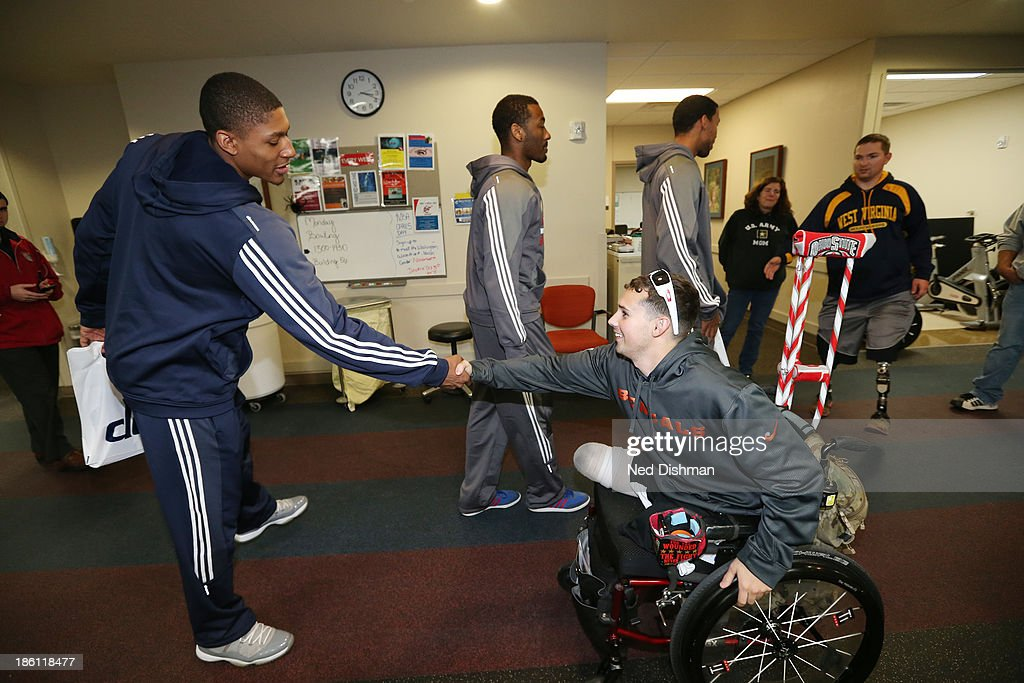 Bradley Beal #3 of the Washington Wizards greets a wounded warrior during a visit to Walter Reed Medical Center on October 25, 2013 in Washington, DC.
