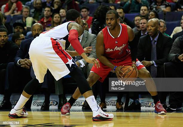 Bradley Beal of the Washington Wizards guards Chris Paul of the Los Angeles Clippers during the first half at Verizon Center on December 12 2014 in...