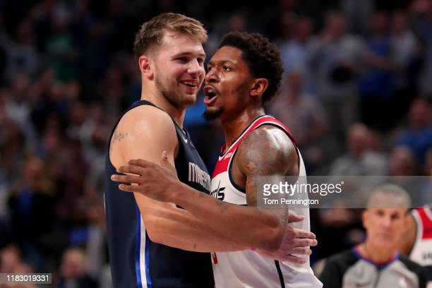 Bradley Beal of the Washington Wizards hugs Luka Doncic of the Dallas Mavericks after being ejected from the game in the fourth quarter at American...