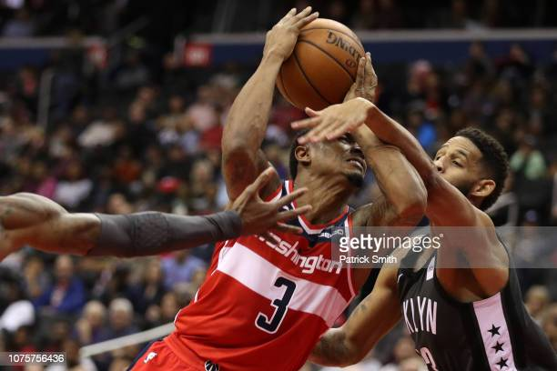 Bradley Beal of the Washington Wizards is fouled by Allen Crabbe of the Brooklyn Nets during the first half at Capital One Arena on December 01 2018...