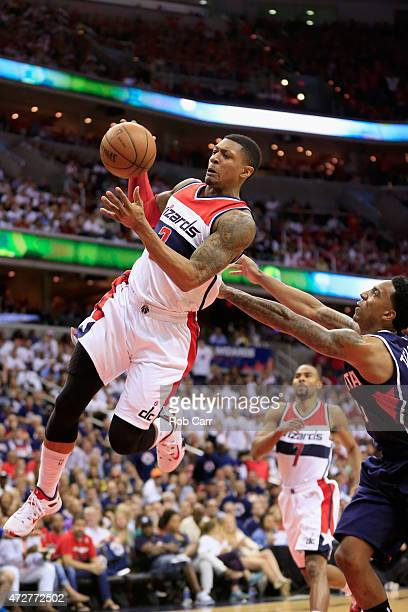 Bradley Beal of the Washington Wizards is fouled by Jeff Teague of the Atlanta Hawks in the second quarter of Game Three of the Eastern Conference...