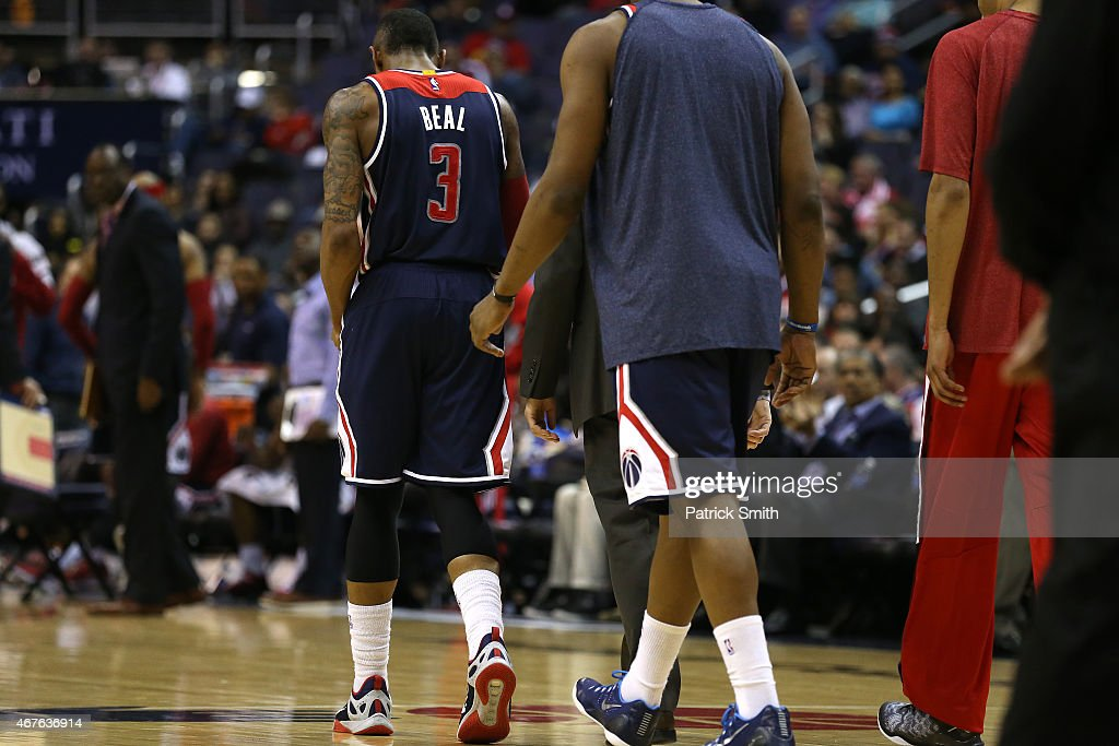 Bradley Beal #3 of the Washington Wizards leaves the court after an injury against the Indiana Pacers at Verizon Center on March 25, 2015 in Washington, DC. The Indiana Pacers won, 103-101.