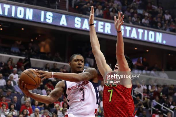 Bradley Beal of the Washington Wizards passes around Ersan Ilyasova of the Atlanta Hawks in the first half in Game Five of the Eastern Conference...
