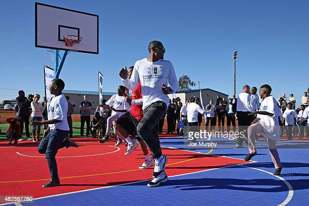 Bradley Beal of the Washington Wizards runs up court during the Boys and Girls club court dedication as part the Basketball Without Boarders program...