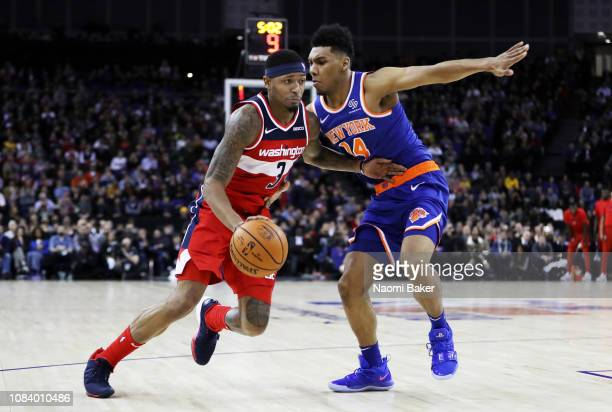 Bradley Beal of the Washington Wizards runs with the ball as Allonzo Trier of the New York Knicks looks on during the NBA London game 2019 between...