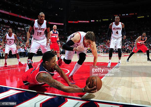 Bradley Beal of the Washington Wizards saves the ball from going out of bounds against Kyle Korver of the Atlanta Hawks in Game Five of the Eastern...