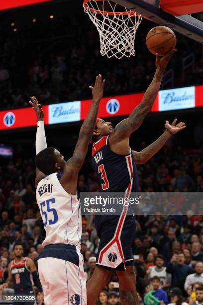 Bradley Beal of the Washington Wizards scores the gamewinning basket in front of Delon Wright of the Dallas Mavericks during the second half at...