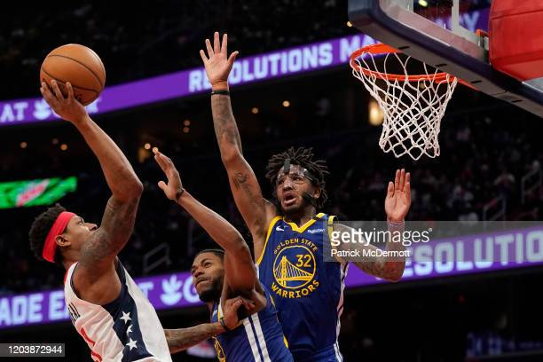 Bradley Beal of the Washington Wizards shoots against Glenn Robinson III and Marquese Chriss of the Golden State Warriors in the second half at...