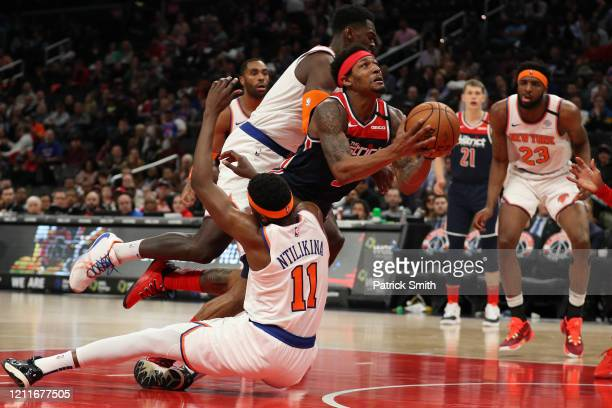 Bradley Beal of the Washington Wizards shoots in front of Frank Ntilikina of the New York Knicks during the second half at Capital One Arena on March...
