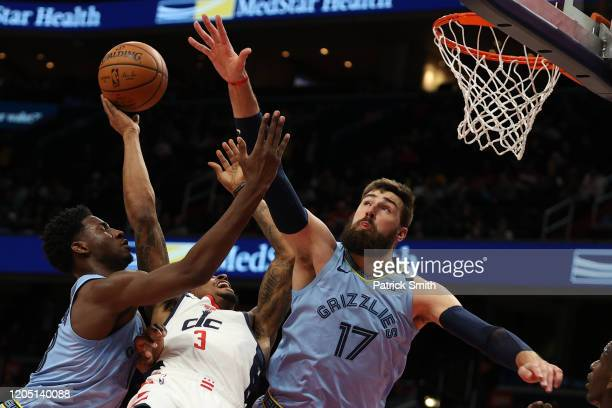 Bradley Beal of the Washington Wizards shoots in front of Jonas Valanciunas of the Memphis Grizzlies during the first half at Capital One Arena on...