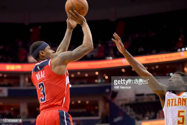 Bradley Beal of the Washington Wizards shoots over Daniel Hamilton of the Atlanta Hawks during the second half at Capital One Arena on January 2 2019...