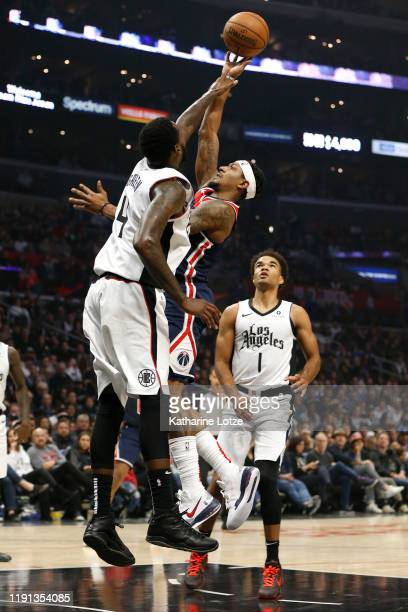 Bradley Beal of the Washington Wizards shoots the ball as JaMychal Green of the Los Angeles Clippers defends during the first half at Staples Center...