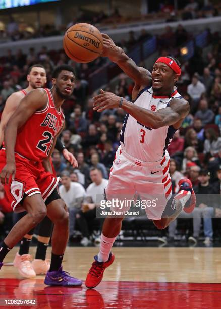 Bradley Beal of the Washington Wizards slips as he tries to pass against the Chicago Bulls at the United Center on February 23 2020 in Chicago...