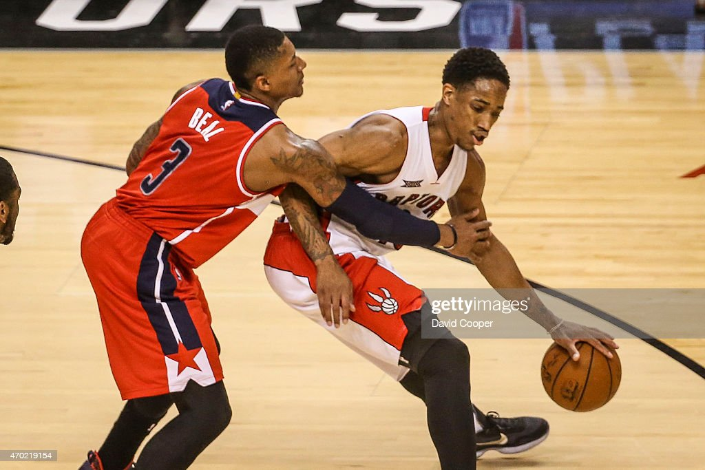 TORONTO, ON- APRIL 18 - Bradley Beal (3) of the Washington Wizards takes a foul on DeMar DeRozan (10) of the Toronto Raptors as the clock winds down in the 2nd quarter of the game between the Toronto Raptors and the Washington Wizards at the Air Canada Centre April 18, 2015