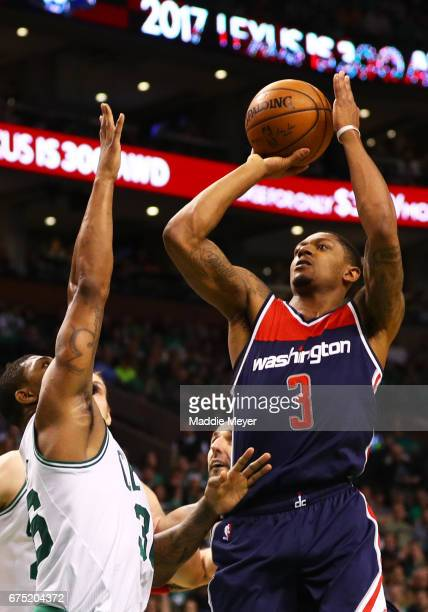 Bradley Beal of the Washington Wizards takes a shot over Marcus Smart of the Boston Celtics during the second quarter of Game One of the Eastern...