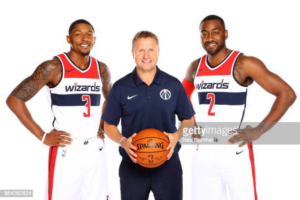 Bradley Beal Scott Brooks and John Wall of the Washington Wizards pose for a portrait during Media Day on September 25 2017 at Capital One Center in...