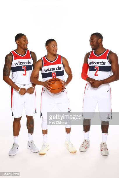 Bradley Beal Tim Frazier and John Wall of the Washington Wizards pose for a portrait during Media Day on September 25 2017 at Capital One Center in...