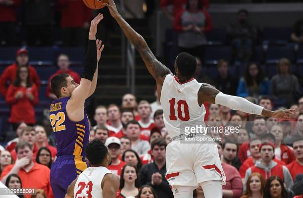 Bradley Braves forward Elijah Childs tries to block a shot by UNI Panthers guard Wyatt Lohaus during a Missouri Valley Conference Basketball...