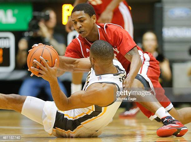 Bradley Braves guard Tramique Sutherland dives for a loose ball against Wichita State Shockers guard Tekele Cotton during the first half on Wednesday...