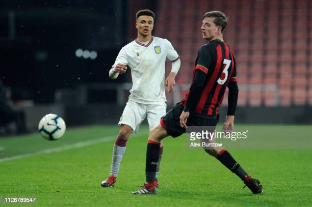 Bradley Burton of Aston Villa passes the ball under pressure from Tom Hanfrey of AFC Bournemouth during the FA Youth Cup Fifth Round Match between...