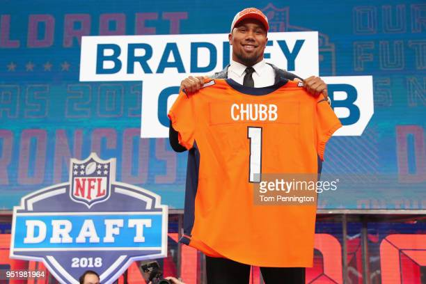 Bradley Chubb of NC State poses after being picked overall by the Denver Broncos during the first round of the 2018 NFL Draft at ATT Stadium on April...