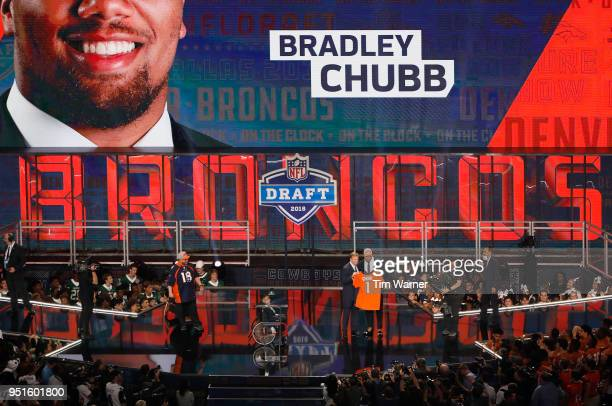 Bradley Chubb of NC State poses with NFL Commissioner Roger Goodell after being picked overall by the Denver Broncos during the first round of the...