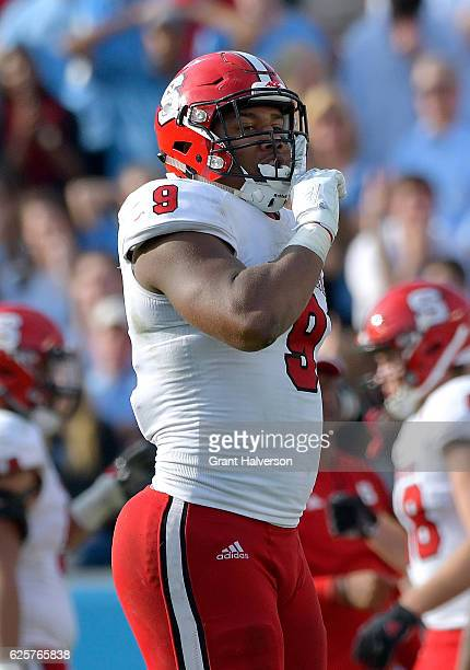 Bradley Chubb of the North Carolina State Wolfpack gesture to the crowd during their win against the North Carolina Tar Heels at Kenan Stadium on...