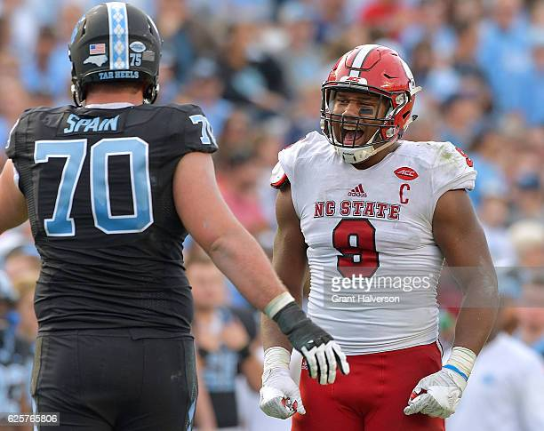 Bradley Chubb of the North Carolina State Wolfpack has words for Caleb Peterson of the North Carolina Tar Heels during their game at Kenan Stadium on...