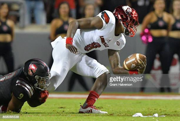 Bradley Chubb of the North Carolina State Wolfpack sacks Lamar Jackson of the Louisville Cardinals during the game at Carter Finley Stadium on...
