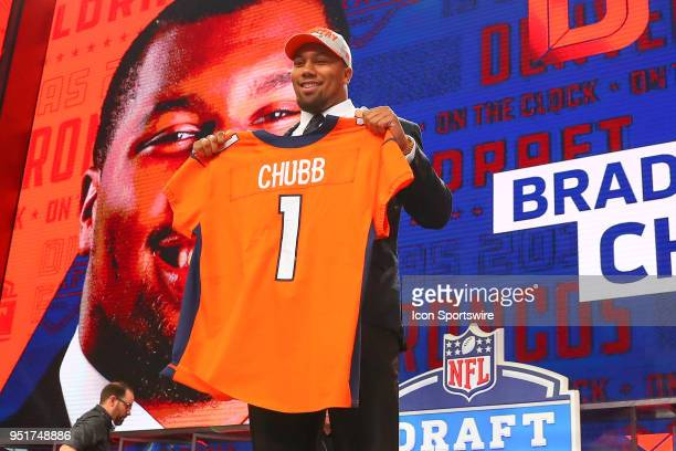 Bradley Chubb poses for photos as the fifth overall pick by the Denver Broncos during the first round at the 2018 NFL Draft at ATT Statium on April...