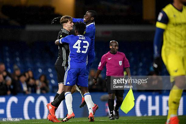 Bradley Collins Kurt Zouma and Fankaty Dabo of Chelsea celebrate winning the penalty shoot out during a Checkatrade Trophy match between Chelsea and...