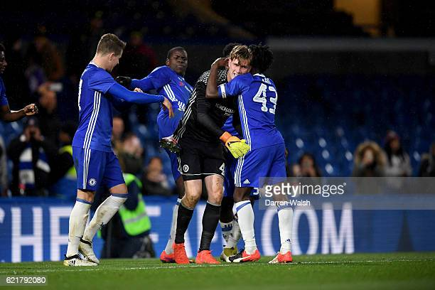 Bradley Collins Kurt Zouma Marco van Ginkel and Fankaty Dabo of Chelsea celebrate winning the penalty shoot out during a Checkatrade Trophy match...