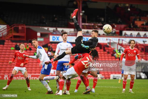 Bradley Collins of Barnsley clashes with team mate Toby Sibbick as he attempts to catch the ball during the FA Cup Third Round match between Barnsley...