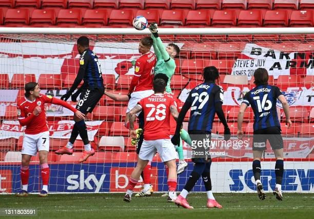 Bradley Collins of Barnsley FC punching the ball away during the Sky Bet Championship match between Barnsley and Middlesbrough at Oakwell Stadium on...