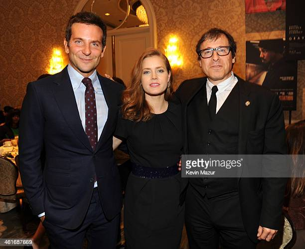 Bradley Cooper Amy Adams and David O Russell attend the 14th annual AFI Awards Luncheon at the Four Seasons Hotel Beverly Hills on January 10 2014 in...