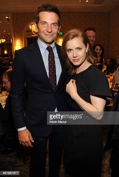 Bradley Cooper and Amy Adams attend the 14th annual AFI Awards Luncheon at the Four Seasons Hotel Beverly Hills on January 10 2014 in Beverly Hills...