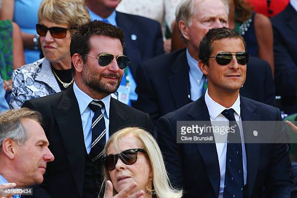 Bradley Cooper and Bear Grylls in the royal box for the Gentlemen's Singles semifinal match between Novak Djokovic of Serbia and Grigor Dimitrov of...