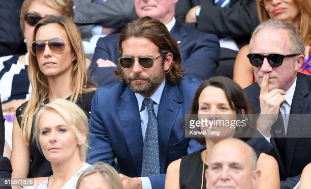 Bradley Cooper and FrancoisHenri Pinault attend day 13 of Wimbledon 2017 on July 16 2017 in London England