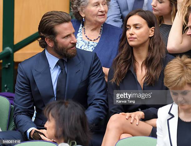 Bradley Cooper and Irina Shayk attend the Men's Final of the Wimbledon Tennis Championships between Milos Raonic and Andy Murray at Wimbledon on July...