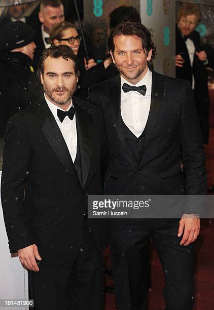 Bradley Cooper and Joaquin Phoenix attend the EE British Academy Film Awards at The Royal Opera House on February 10 2013 in London England