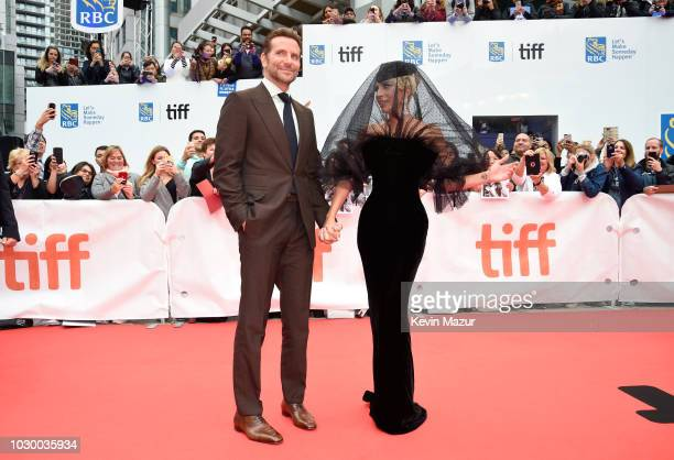 Bradley Cooper and Lady Gaga attends the A Star Is Born premiere during 2018 Toronto International Film Festival at Roy Thomson Hall on September 9...